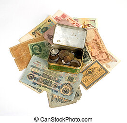 Old currency and metal box with old coins