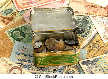 Old currency and box with old coins