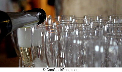 Waiter is pouring Champagne on Empty Glasses - Waiter is...