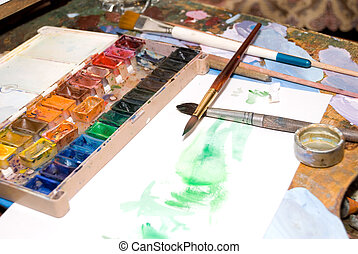 Water colour brushes and paints prepared for drawing