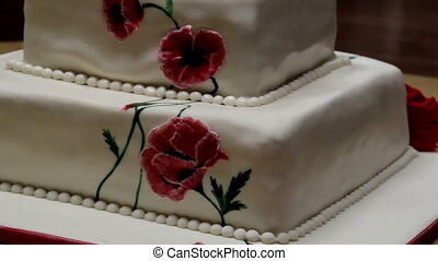 Red Flower Decorated Fondant two-layered Cake - A white...