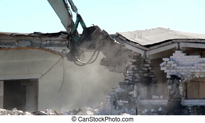 Damaged Property bulldozer in action and destroying a house...