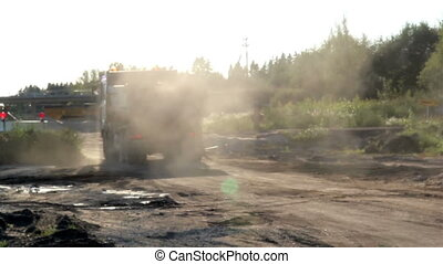 A dump truck after unloading and leaving the site barricaded by a stop sign