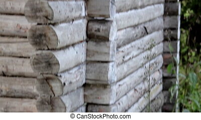 A pile of wooden blocks made cabin wall