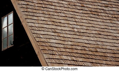 Footage of the close-up view of the old cabin cedar wooden shingle shake roofFootage of the side of the cabin
