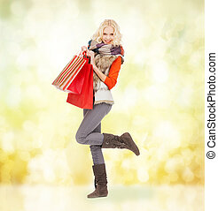 teenage girl in winter clothes with shopping bags - retail...
