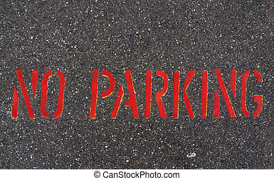 No Parking sign on asphalt street pavement.