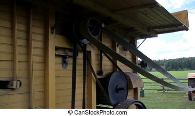The home made old time noisy farm machine causing a...