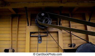 The home made old time noisy farm machine and the wheel in the Straw Hammer Mill Engine Turned Off