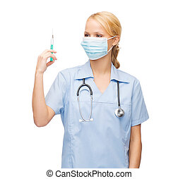 female doctor or nurse in mask holding syringe - healthcare...