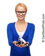 smiling woman wearing and holding eyeglasses - vision and...