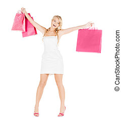 woman with shopping bags in dress and high heels - retail...