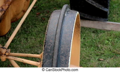 A small old time antique farm tractor wheel and steering...