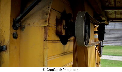 Cow mooing and close up image of old time farm hammer mill -...