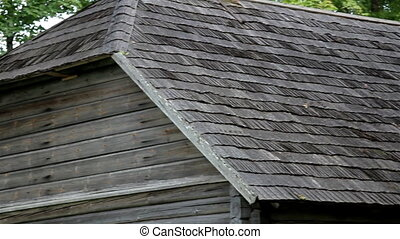 The old cedar wooden shingle shake roof of the log house are...