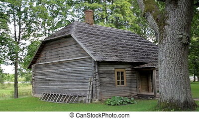 The old wooden log house made in lumbers surrounded with...