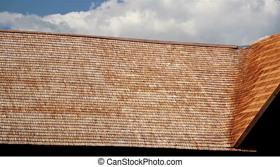 Large and Brown wooden tar colored shingle roof - A large...