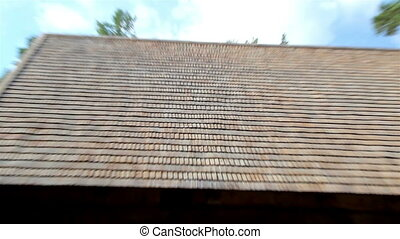 The brown wooden shingle shake roof of a big house - A close...