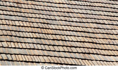 The brown wooden shingle shake roof of a big house - An even...