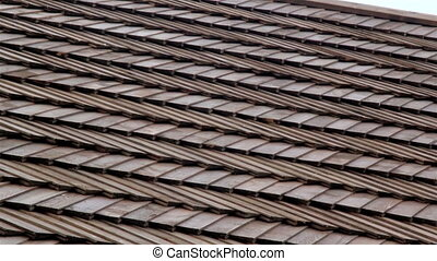 The cedar wooden shingle roof of the house shake - Closer...