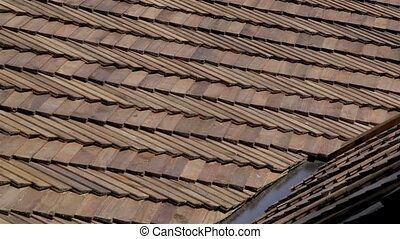 The oiled cedar wooden shingle roof of the house - Close up...