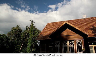 Close-up The oiled cedar wooden shingle roof of the house...