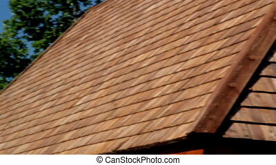View of the side of the tar oiled cedar wooden shingle roof;...