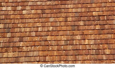 Reddish brown cedar wooden shingle roof of the log house -...