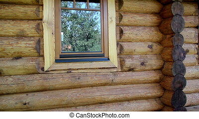 Cabin log house walls its wooden glass window and a new made cedar wooden shingle roof