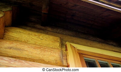 Cabin log house wall and its wooden glass window. The cabin...
