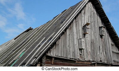 Old cabin log house with bird house - Old cabin log with...