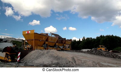 Four gravel buckets in the site and an operating bulldozer