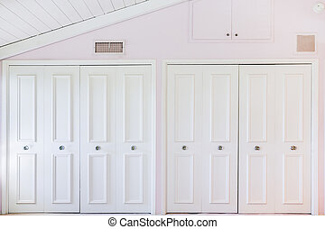 White closet door in pink room