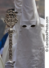 Penitent with staff of silver during a procession of holy...