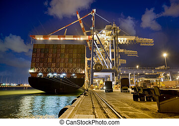 cargo ship by night - cargo ship at dock by night from...