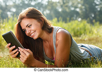 teenage girl using tablet pc