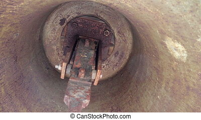 Interior of a big bell up-close image of the rusty bell...