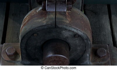 Close image of the steel bolt in the beam rusty big metal...