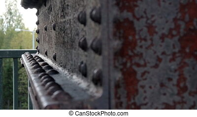 Bolts on rusty old beam The Rusty old beam has big bolts...