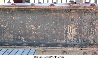 Steel beam on wooden bridge rusty rectangular metal - Steel...