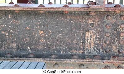 Steel beam on wooden bridge rusty rectangular metal