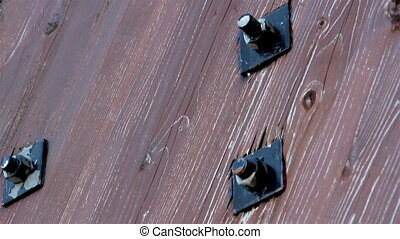 Bolts in the wood set of nuts and bolts