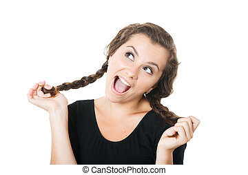 young female playing with her braids looking up mouth open...