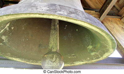 Tiny hole found inside interior the big old steel bell -...