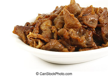 Stir Fried Beef Stips on a White Surface