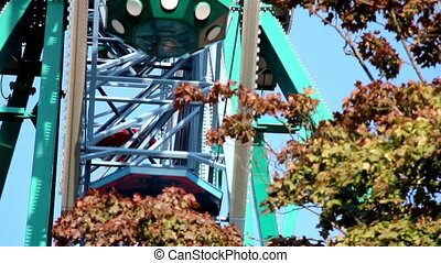Martian themed ferris wheel moving blue sky - Martian themed...