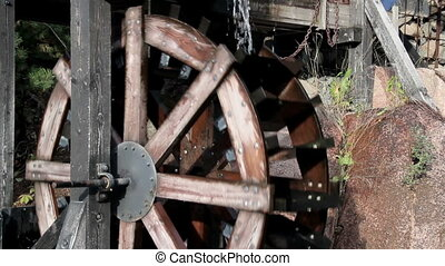Two big water mills working fine The two big water wheels of...
