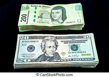 Cash - A stack of Us dollars bills and Mexian Pesos bills...