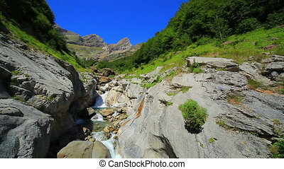 Waterfall at Pyrenees mountains.