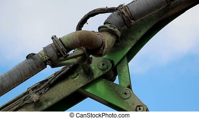 Parts of an un-used backhoe An old green backhoe and...